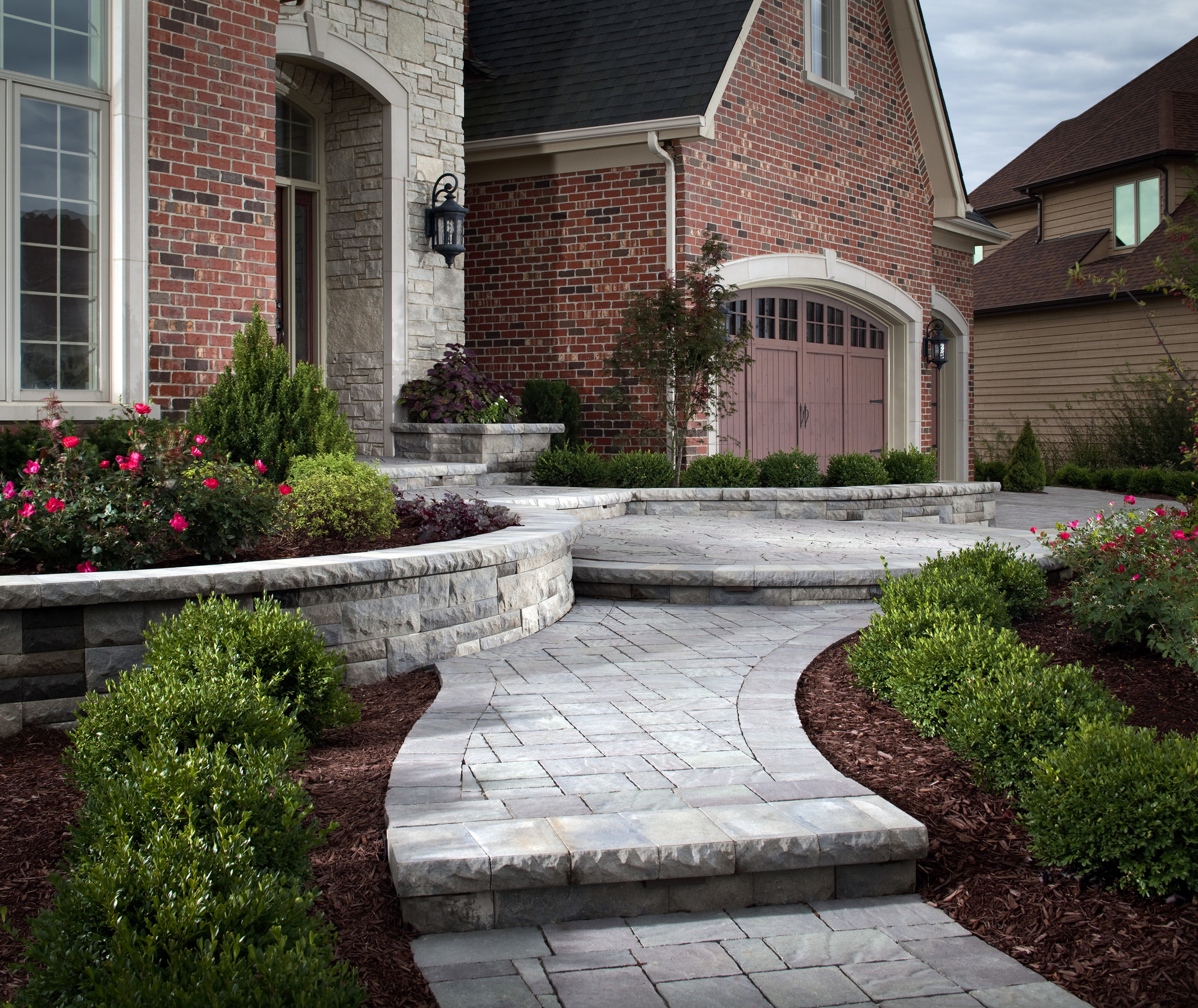 walkway sidewalk landscape design retaining wall steps plantings clean front of home