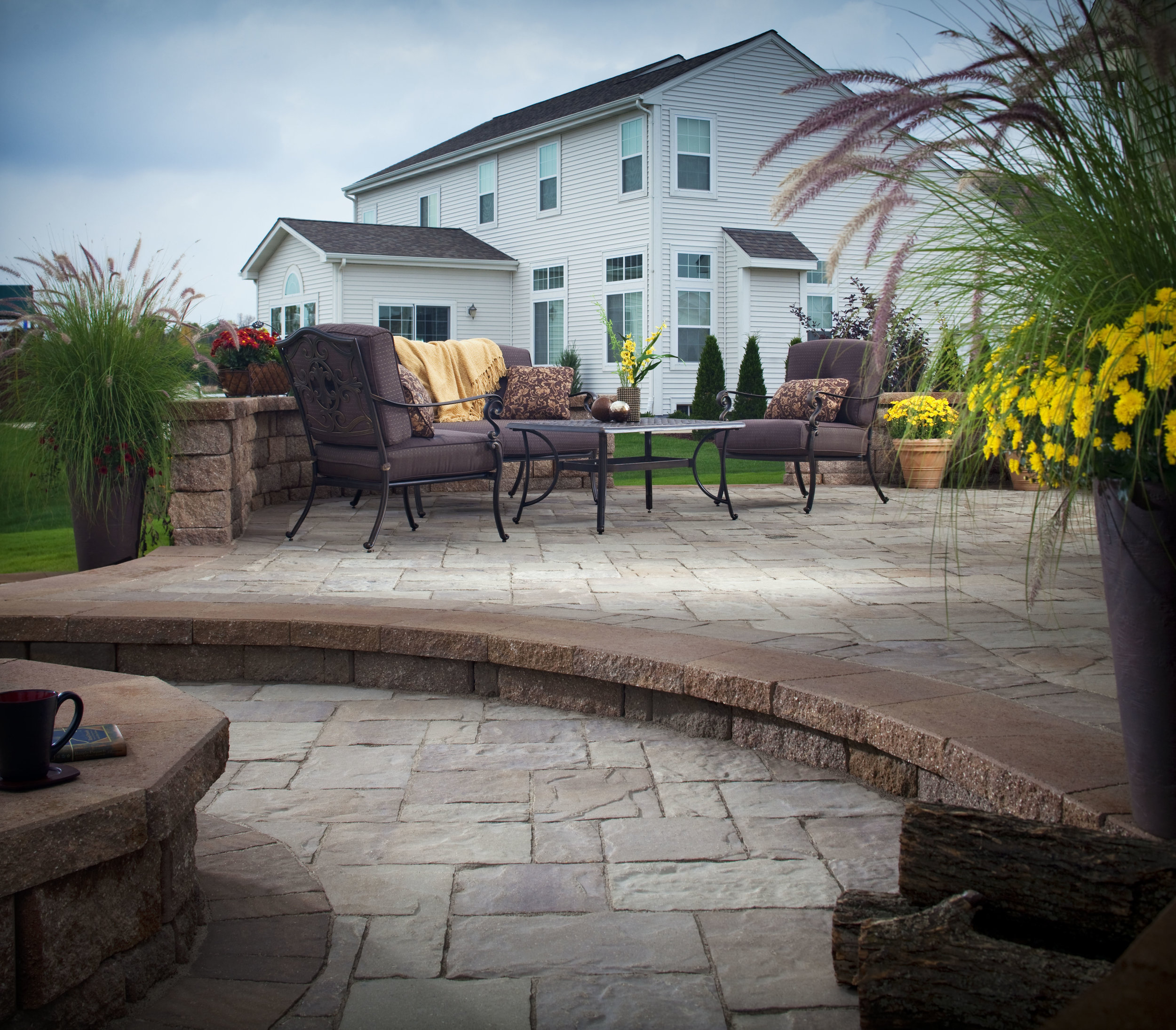 patio sitting wall hardscape landscape design fire pit backyard outdoor getaway outdoor room
