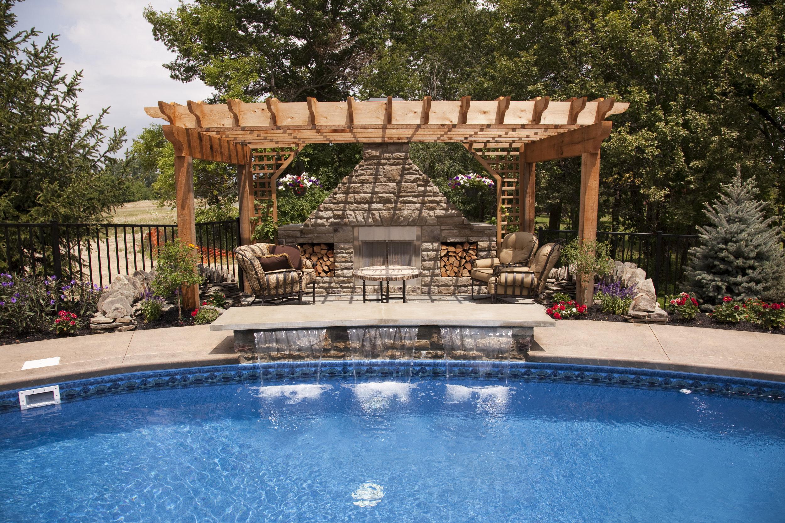 pergola pool fireplace patio landscape design plantings backyard color