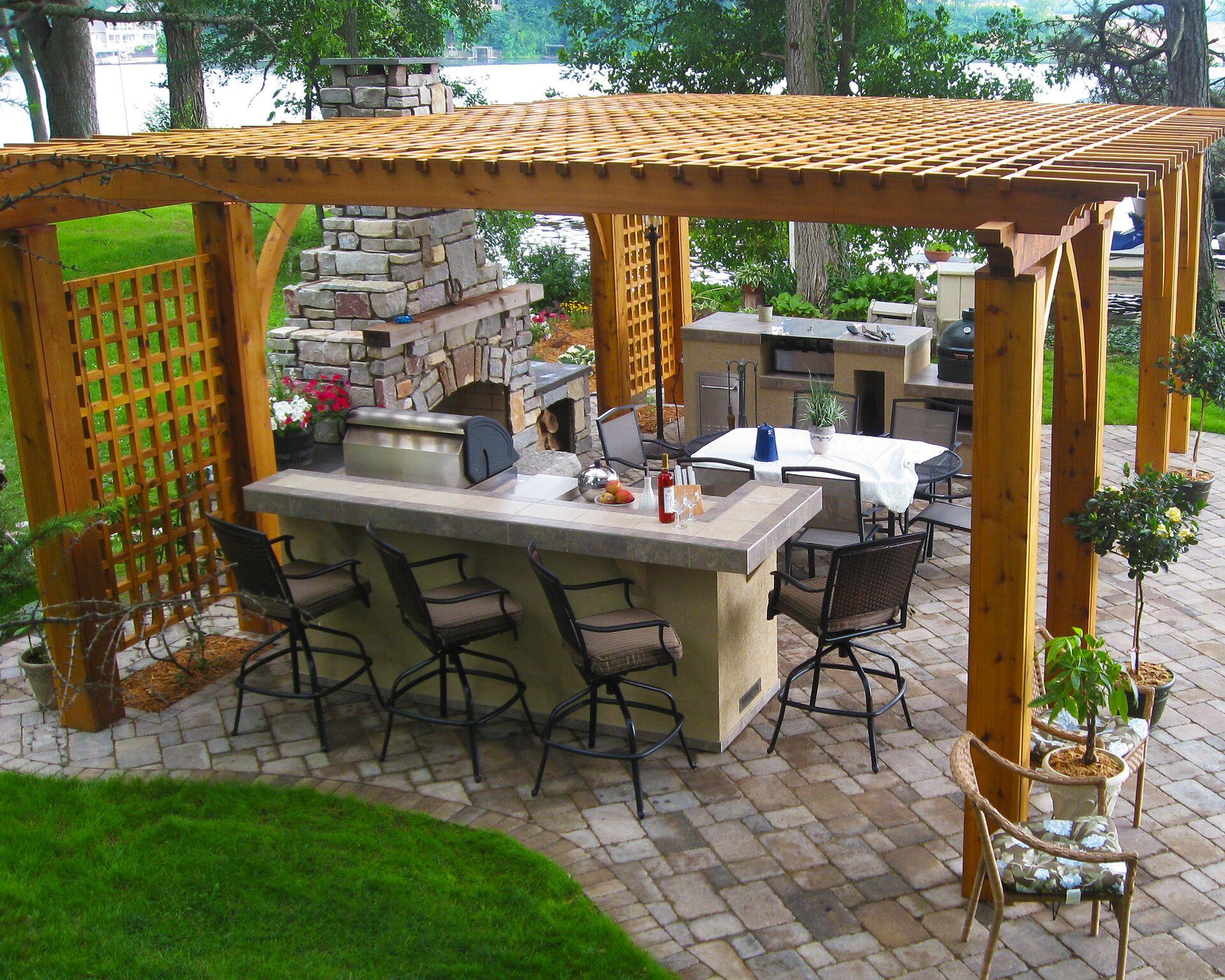 pergola outdoor room kitchen fireplace outdoor space paver hardscape planting landscape design lakefront