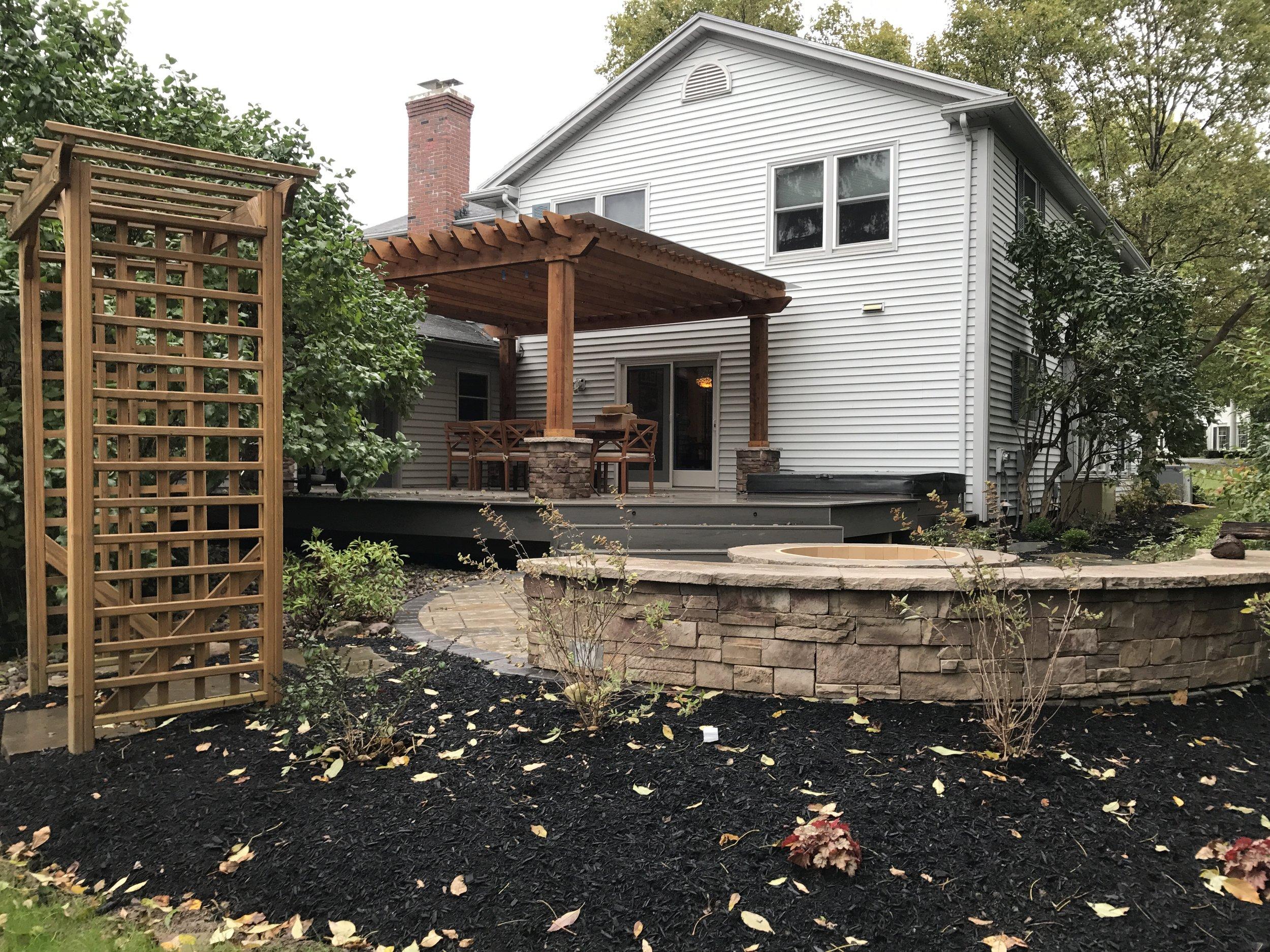 pergola sitting wall fire pit patio arbor trellis deck hot tub landscape design plantings