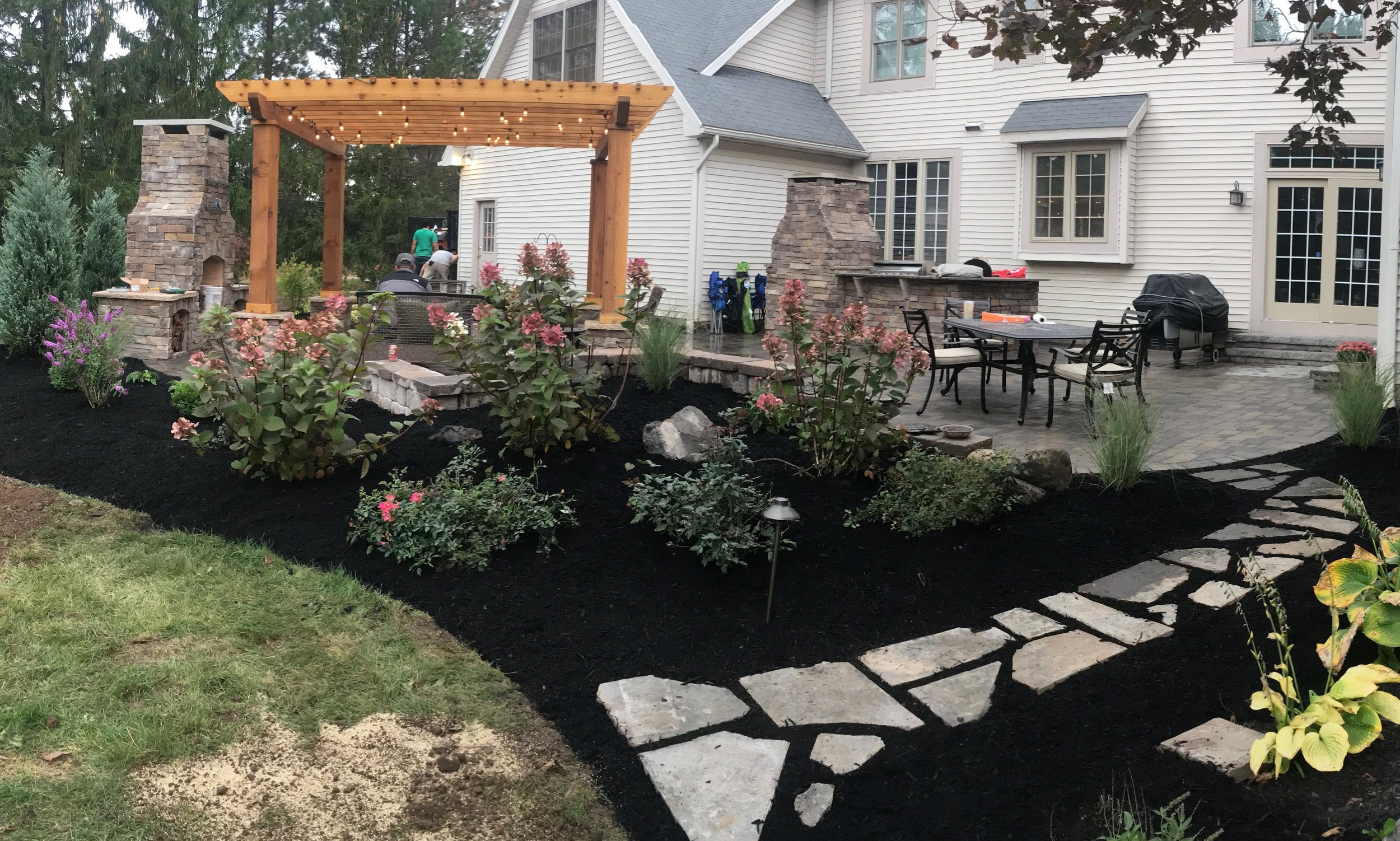 pergola patio fireplace outdoor kitchen outdoor room plantings landscape design