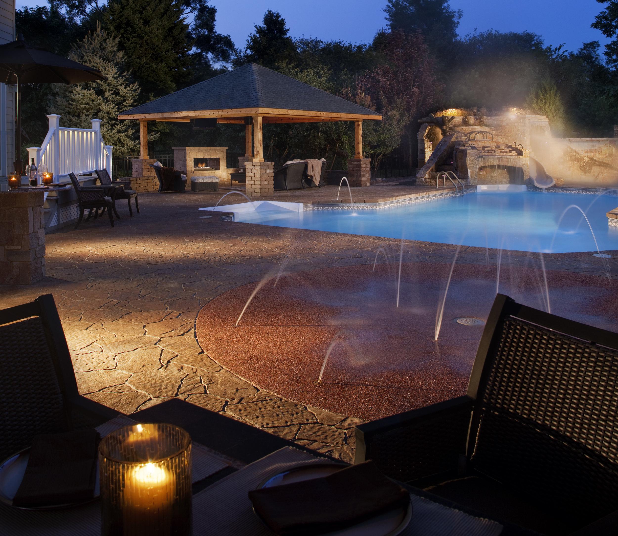 waterfall water slide splash pad patio backyard pavilion outdoor room outdoor lights