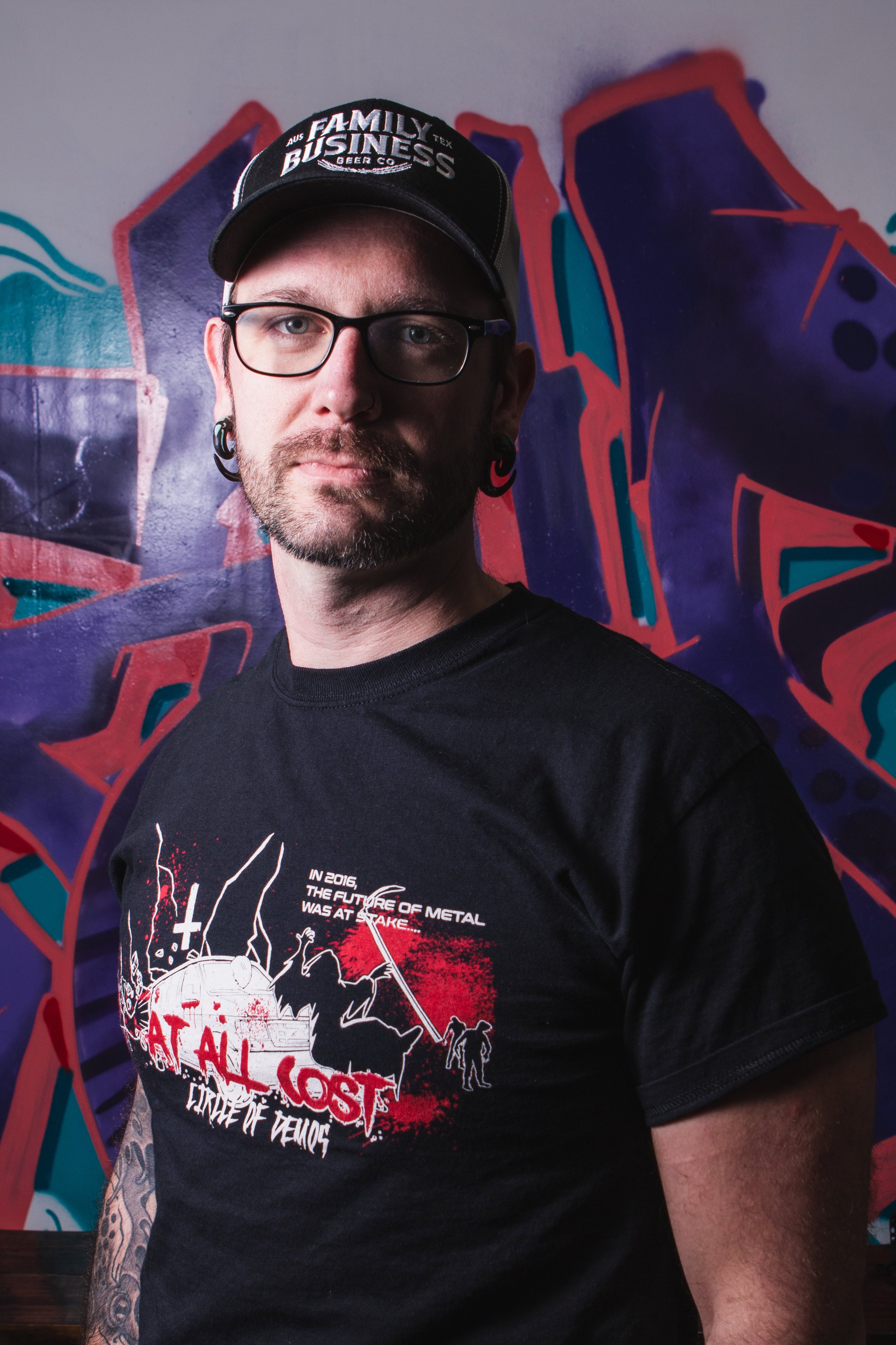 Spang - Hometown: PhiladelphiaFirst moved to Austin: 2004First Beer: Icehouse. Didn't drink again till I moved to Austin.First Coffee Experience: Sipping coffee for hours at the OG bouldin creek, hanging and chatting with the older Austin hippies.What kind of cult would you like to start? Cult of RammsteinYou're a mad scientist, what scientific experiment would you run if money and ethics weren't an issue? I would build and army of alchemically married chimera to do my bidding.What two totally normal things become really weird if you do them back to back? Riding a motorcycle. Listening to vitas.
