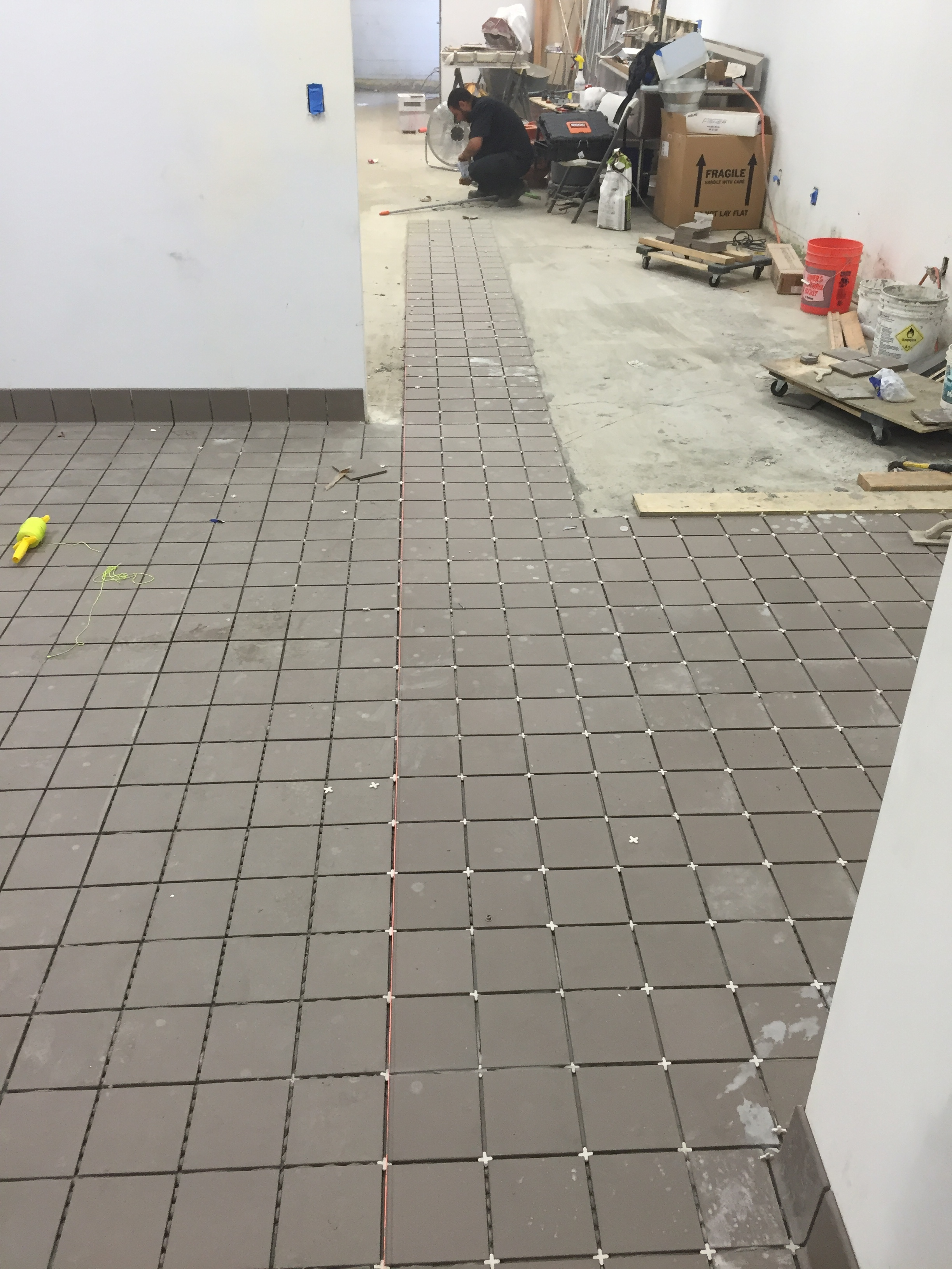 Starting to tile the kitchen