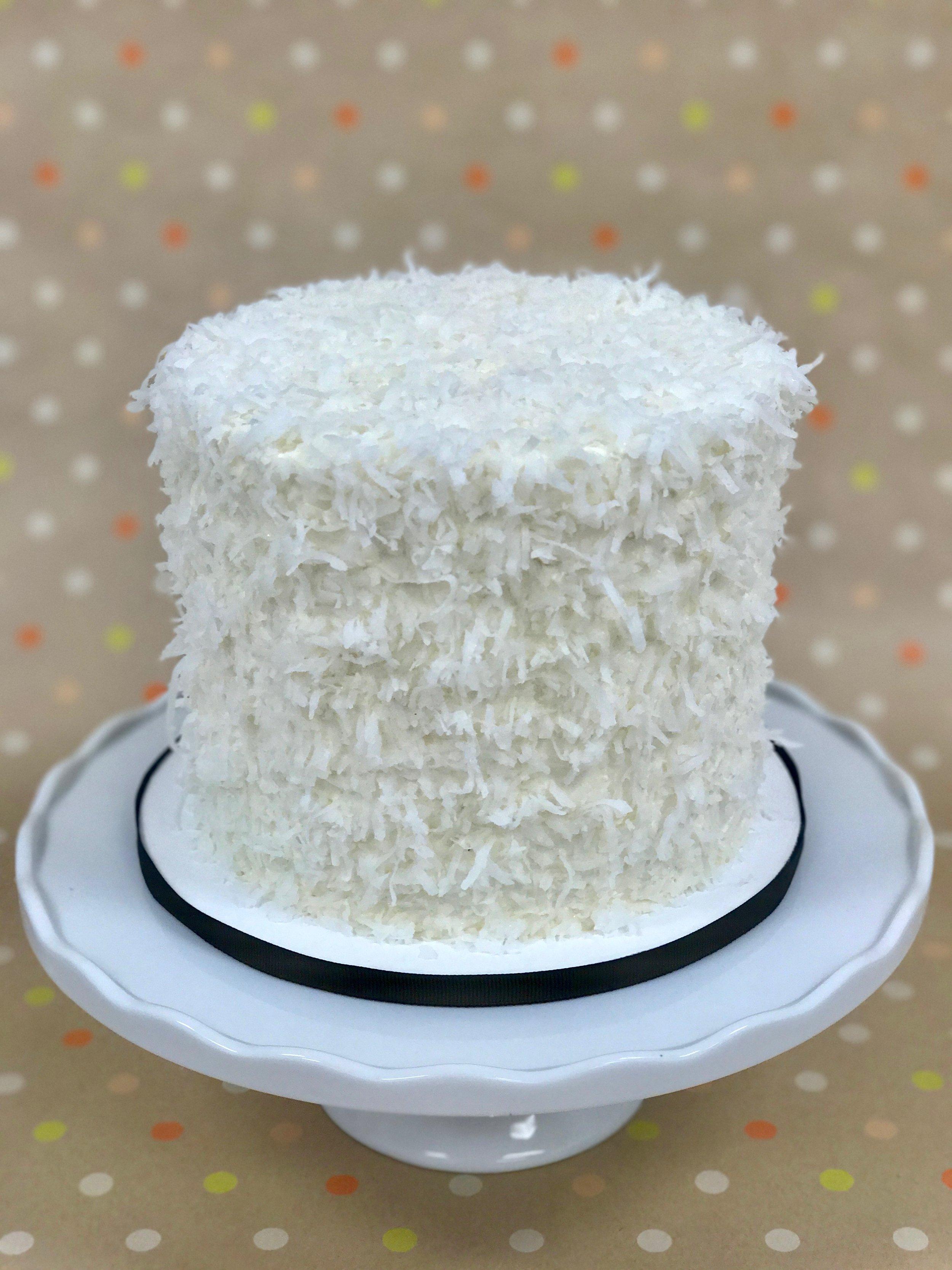 Coconut - Cake: CoconutFilling: Vanilla Cream CheeseFrosting: Vanilla Swiss Meringue Buttercream and Shredded Coconut