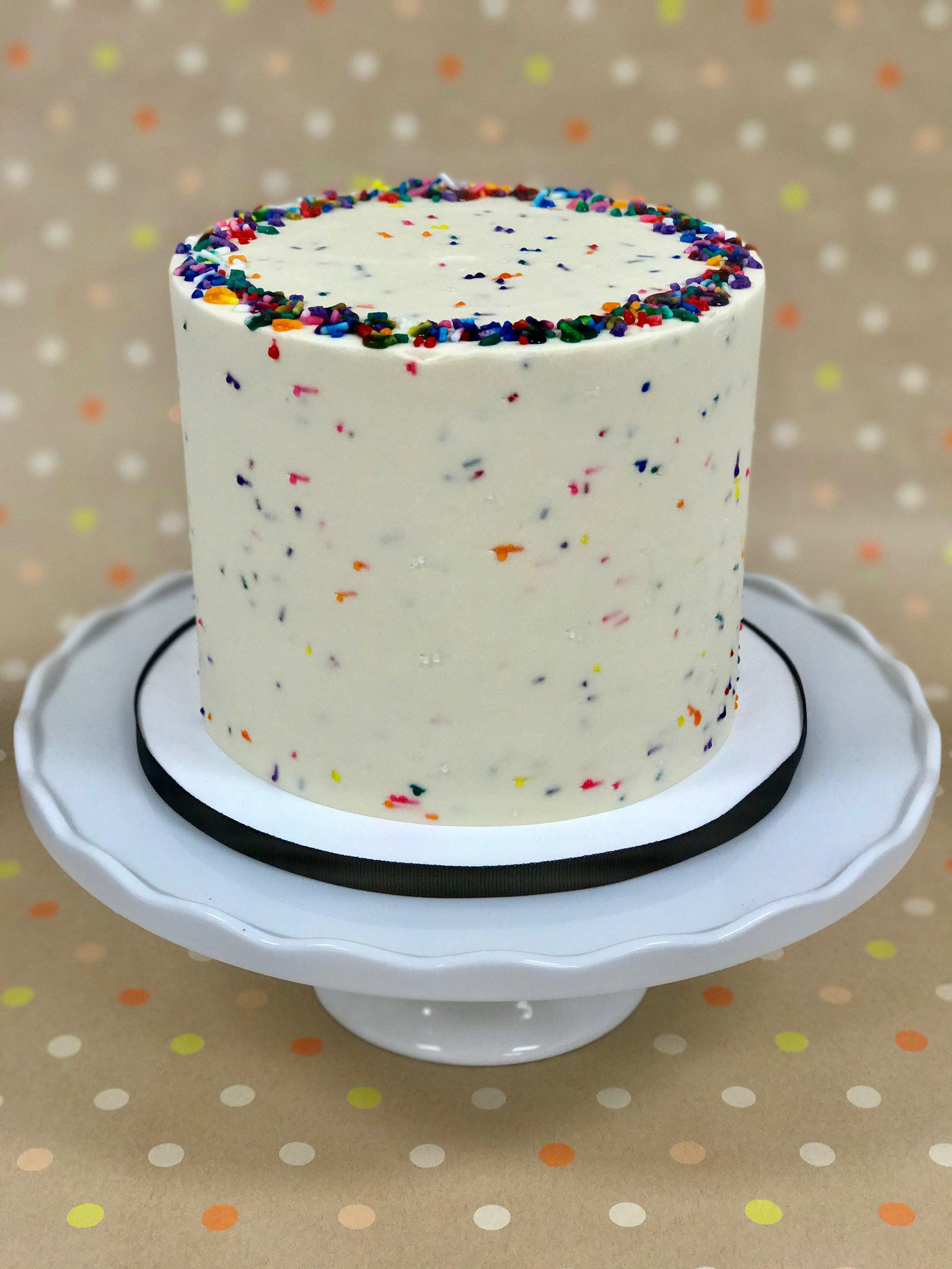 Confetti - Cake: Confetti (white cake with sprinkles)Filling: Confetti Swiss Meringue ButtercreamFrosting: Confetti Swiss Meringue Buttercream and Sprinkles