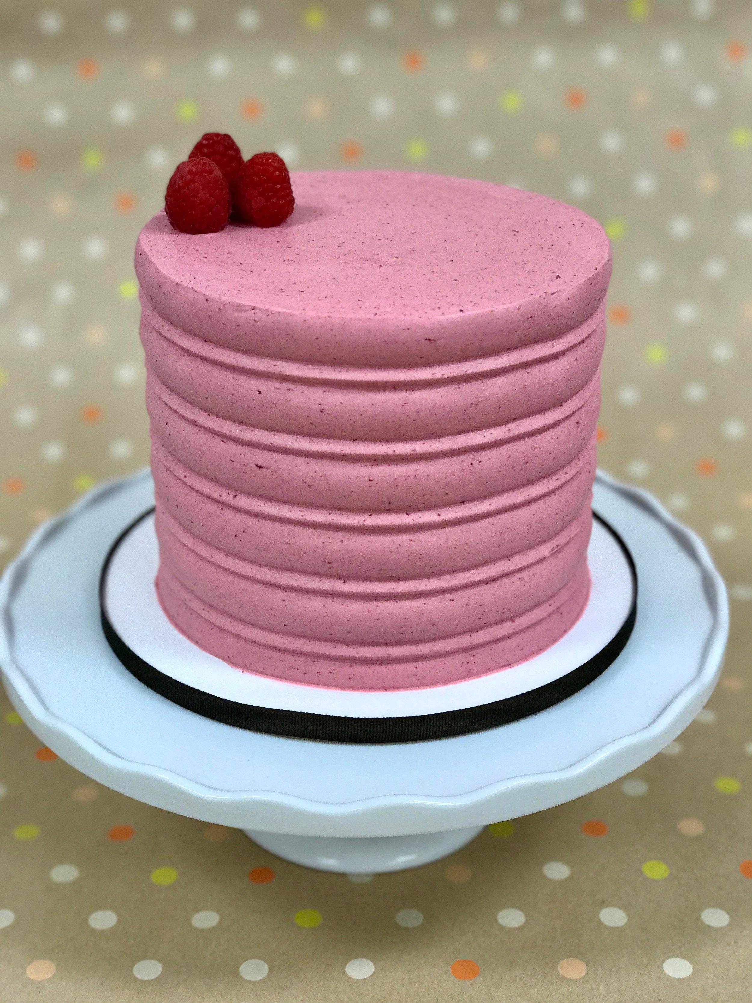 Lemon Raspberry - Cake: Lemon ButtercreamFilling: Raspberry Swiss Meringue ButtercreamFrosting: Raspberry Swiss Meringue Buttercream and Fresh Raspberries