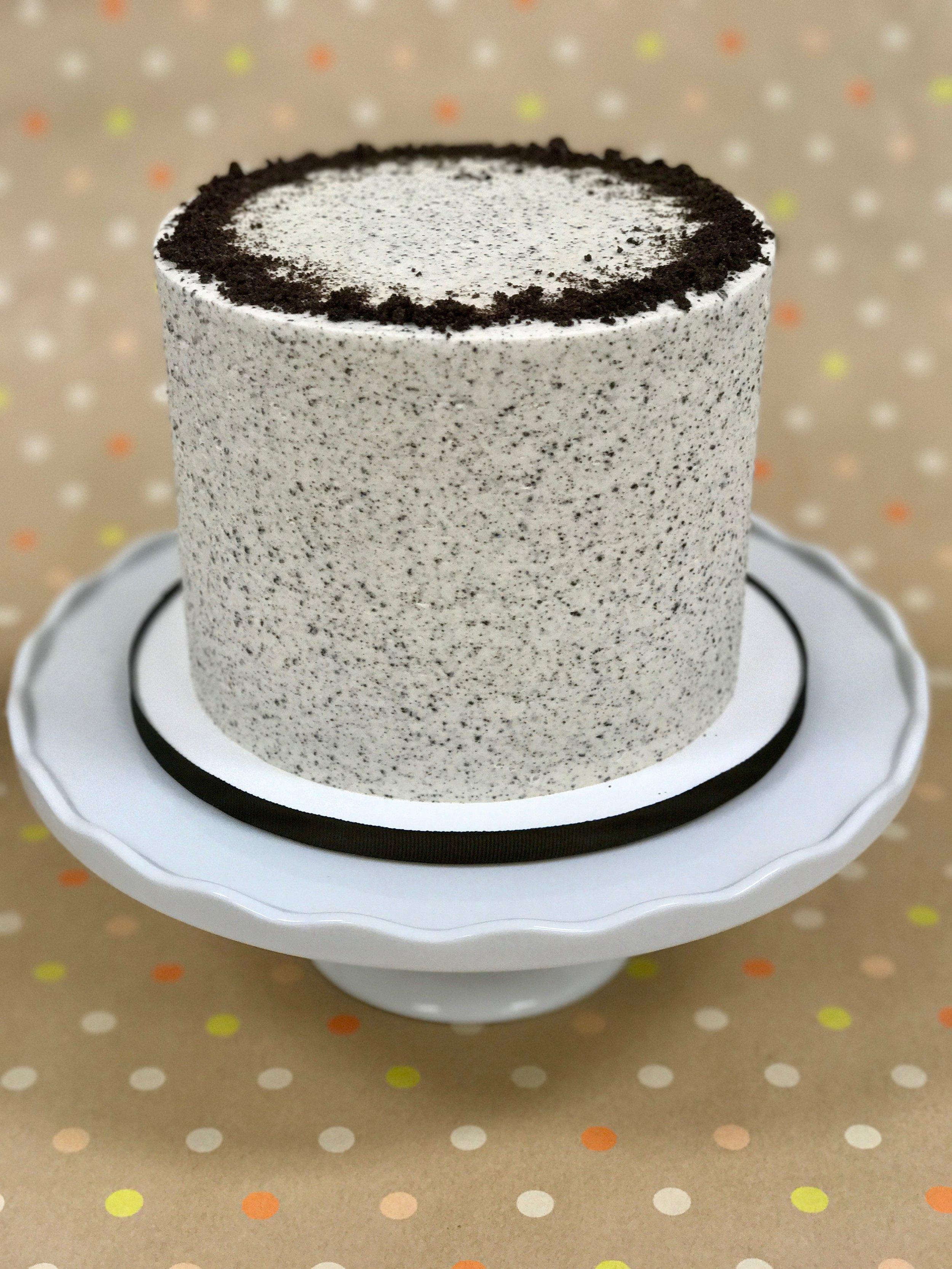 Cookies & Cream - Cake: Vanilla Bean with Crushed OreosFilling: Oreo Swiss Meringue ButtercreamFrosting: Oreo Swiss Meringue Buttercream and Crushed Oreos
