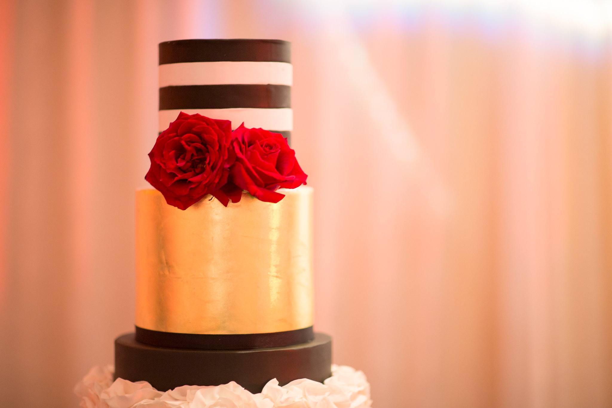 The Knowles Wedding - Custom Design Showcasing fondant ruffling, a tier gilded with 24K gold leaf and black and white stripes for a stunning contrast