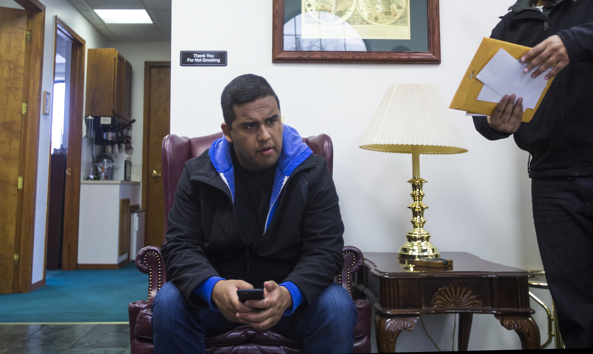 For the fourth time in two months, Edwin Silva waits in the lobby to finalize an I-589 application, withholding of removal, with his immigration lawyer's assistant at the main office in Dearborn.