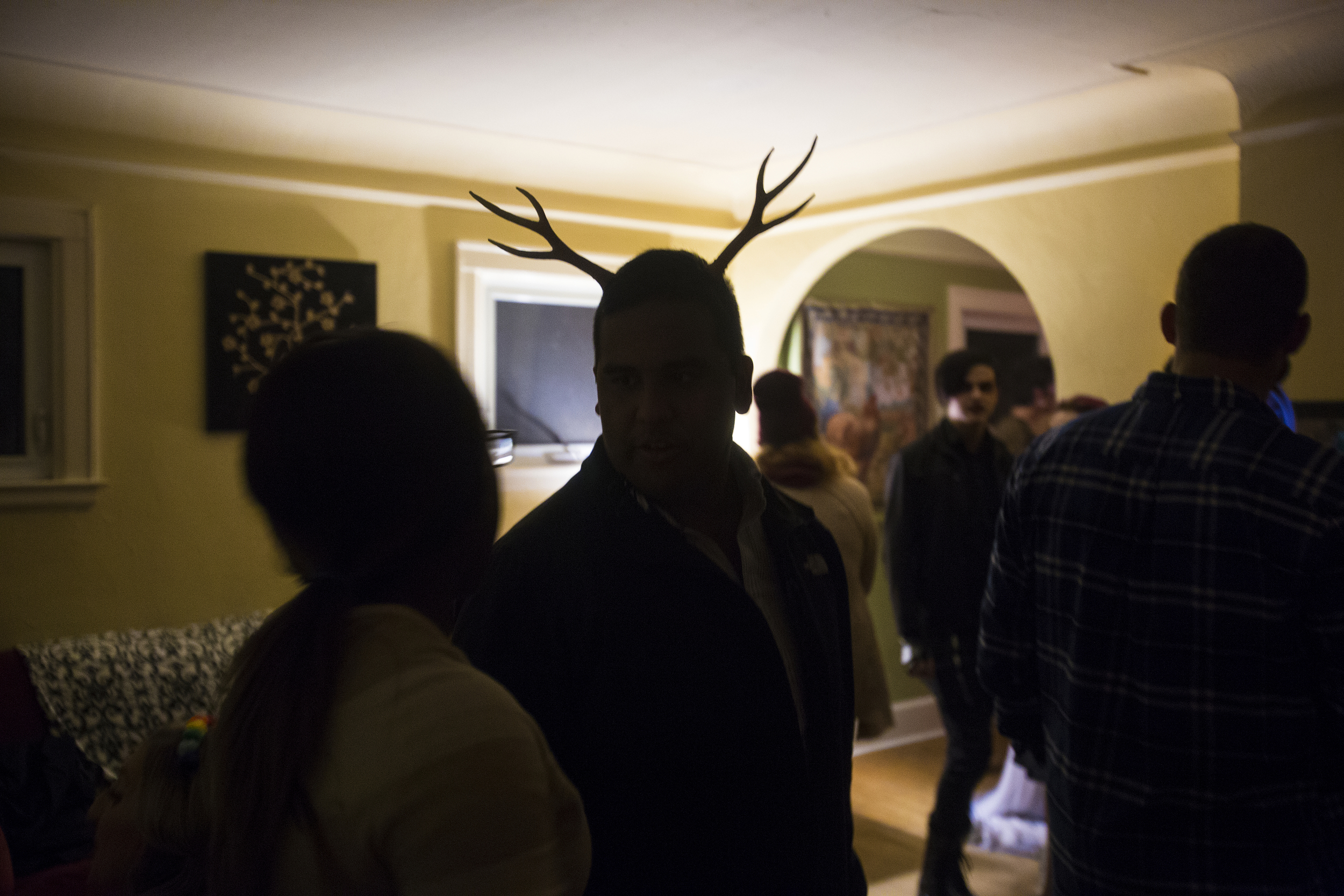 "Dressed as a deer, Edwin Silva socializes with friends at Kory Kalnasy's Halloween party in Wayne.  After Silva arrived, he brought excitement and joy to many people as they shouted his name before sharing hugs.  His friends are very important to him - ""A huge reason why I'm still home is because of my friends and I owe it to them and my family,"" said Silva."