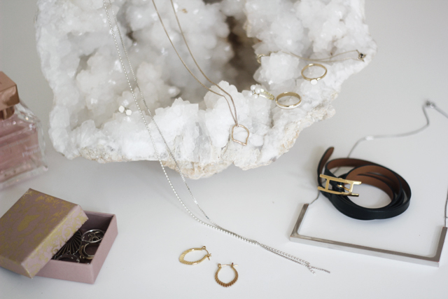 From left to right: Golden earrings by  American Apparel , tiny crystal earrings by  & Other stories ,necklace handmade by  Jolana Nováková , tear necklace by  & Other stories , rings by  & Other stories and  GOLD ATELIER , vintage necklace, leather bracelet by  Hermés and geometrical necklace by  COS .