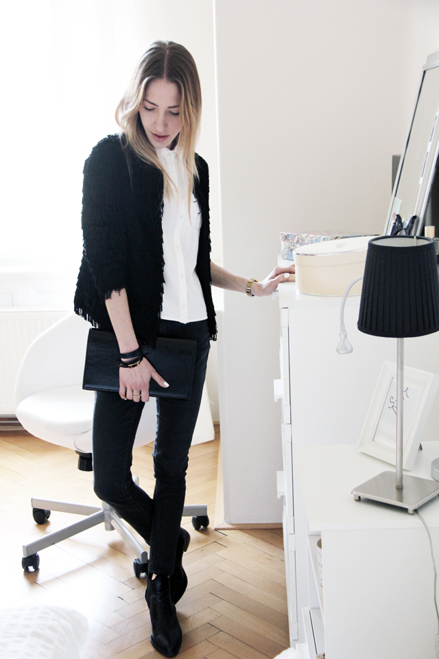 Fringe cardigan  by  Mango , shirt, jeans and boots by  Topshop   and clutch by  Saint Laurent .