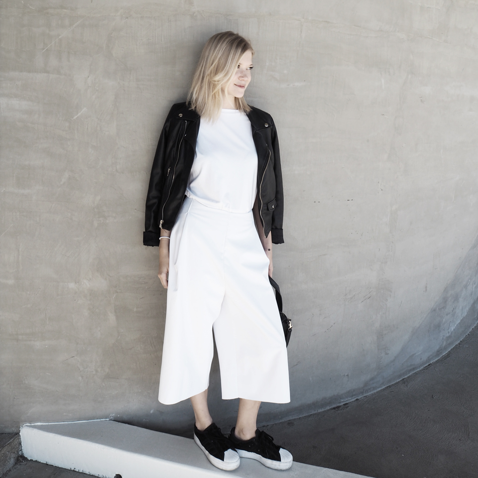 Biker jacket by  Zara , viscose Tee by  WE.RE , softshell culottes by  Odivi  and sneakers by  Adidas .