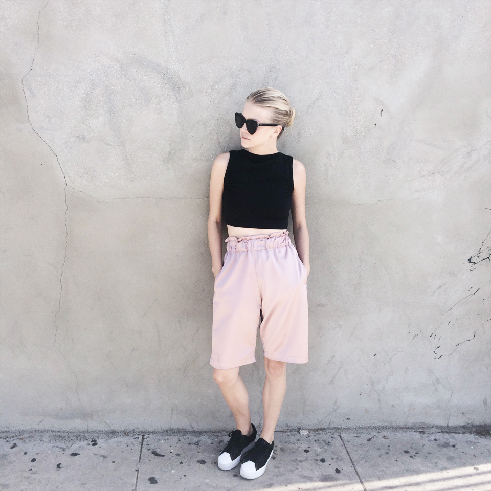 Crop top by  Win Win shop , sunnies by  Komono  (via  Freshlabels.cz ), shorts by  Odivi  and sneakers by  Adidas .