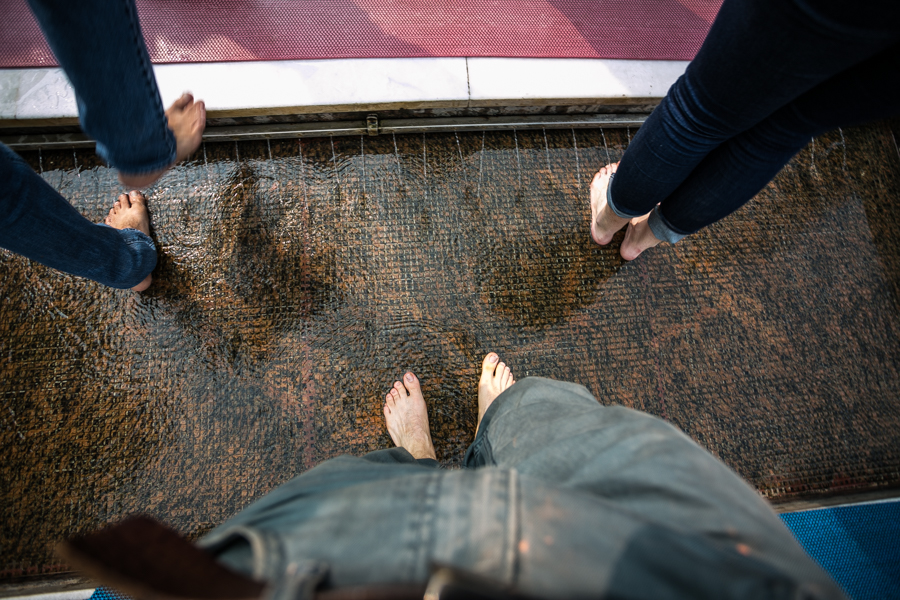 Visitors are required to remove their shoes and wash their feet before entering the temple grounds.