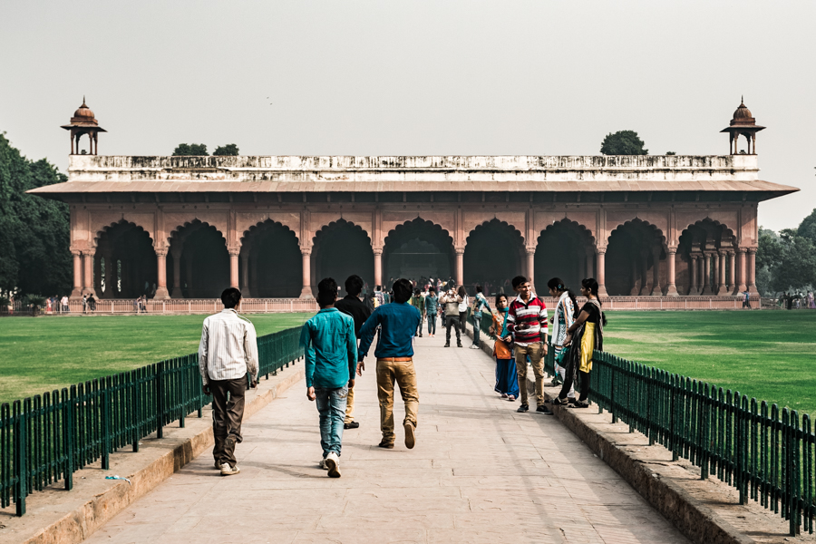 Tourists walking towards the Diwani-i-Am, the historic hall of rulings of the Red Fort where the emperor would issue decrees from his thrown.