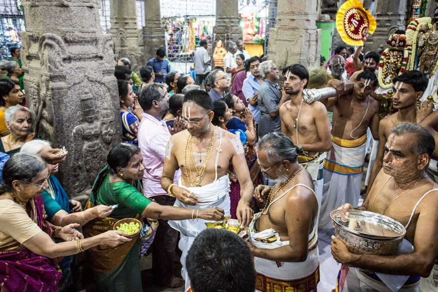 Worshipers giving oblations in the form of fruits at the Parthasarathy temple.