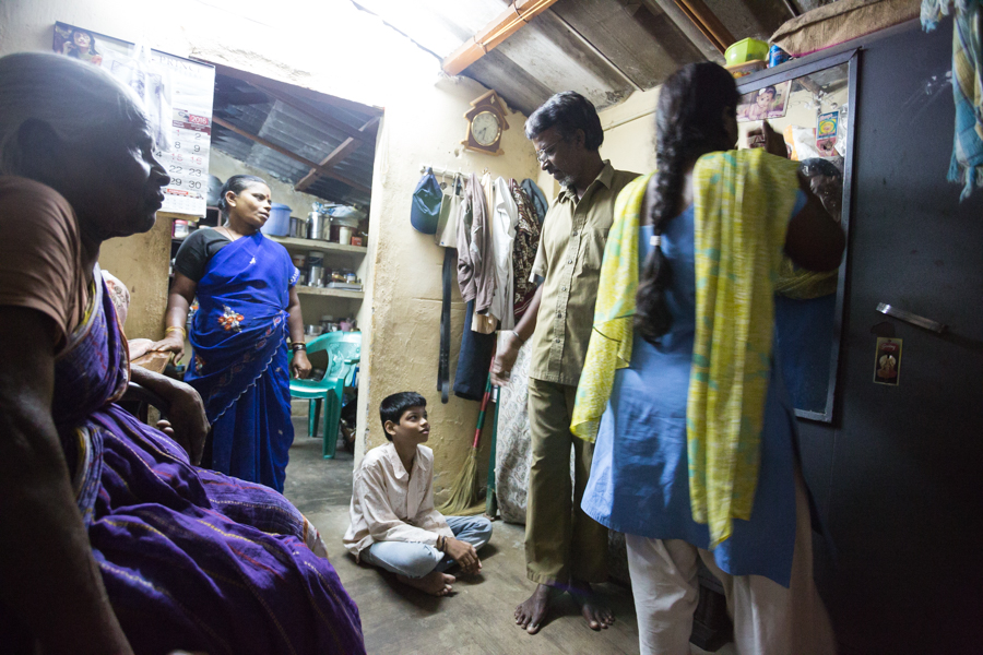 Rajendran and his family in their home.