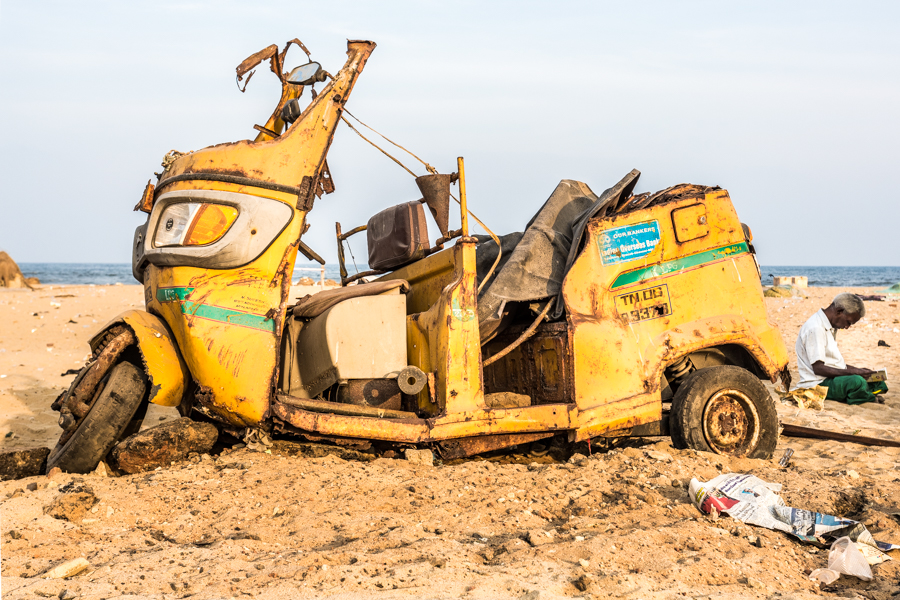 A tuk-tuk decomposing on the beach in Chennai. Although far from pristine, locals still flock to Chennai's beaches to fly kites and picnic.