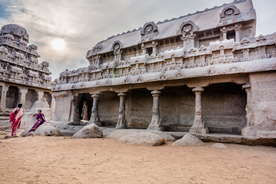 """Mamallapuram's monuments are primarily monolithic temples and cave-carvings of early Dravidian architecture. The Pancha Rathas compound pictured above, contains the Five Rathas. Literally meaning the """"Five Chariots"""", the Rathas are unfinished monolithic temples dating from the late 7th century CE. Each of the monuments are said to resemble a chariot."""