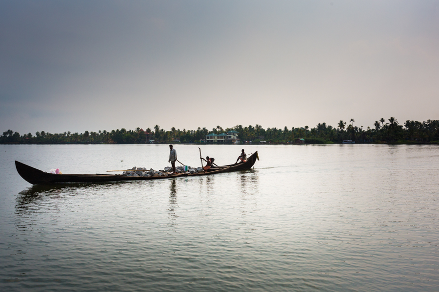Villagers transporting rocks for construction through the backwaters near Alleppey.