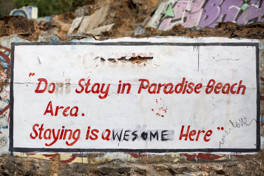 Graffiti in Paradise. Police and Coast Guard typically turn a blind eye to hammock-slinging beach bums coming for a taste of Paradise.