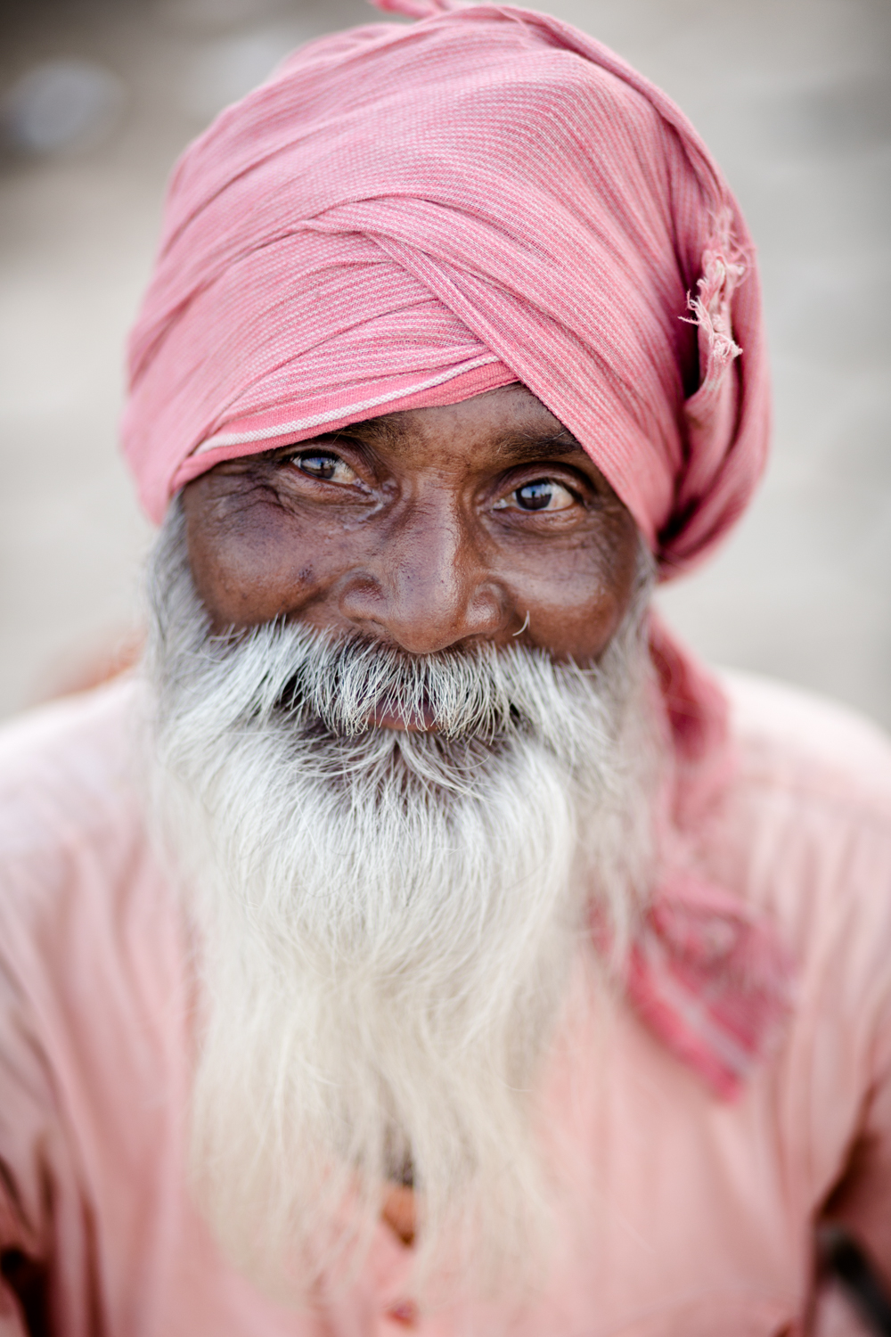 A Sadhu sitting by the Shipra River. Kumbh Mela provides an opportunity for Sadhus (Hindu monks) to interact with lay people.