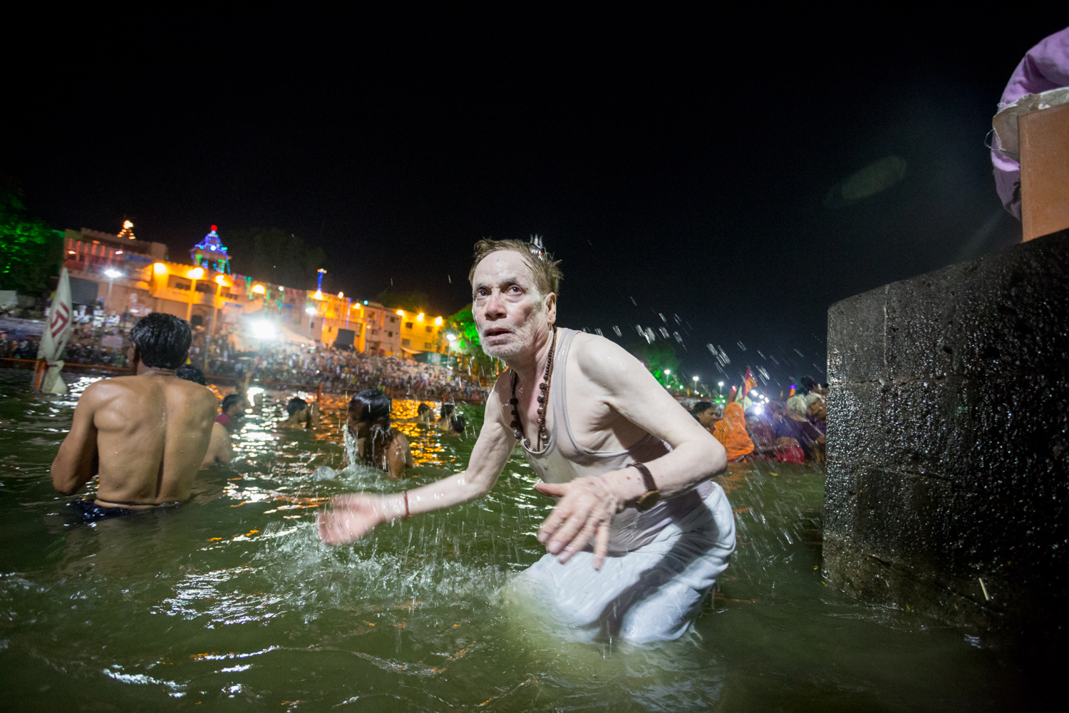 A worshipper bathes in the Shipra river.