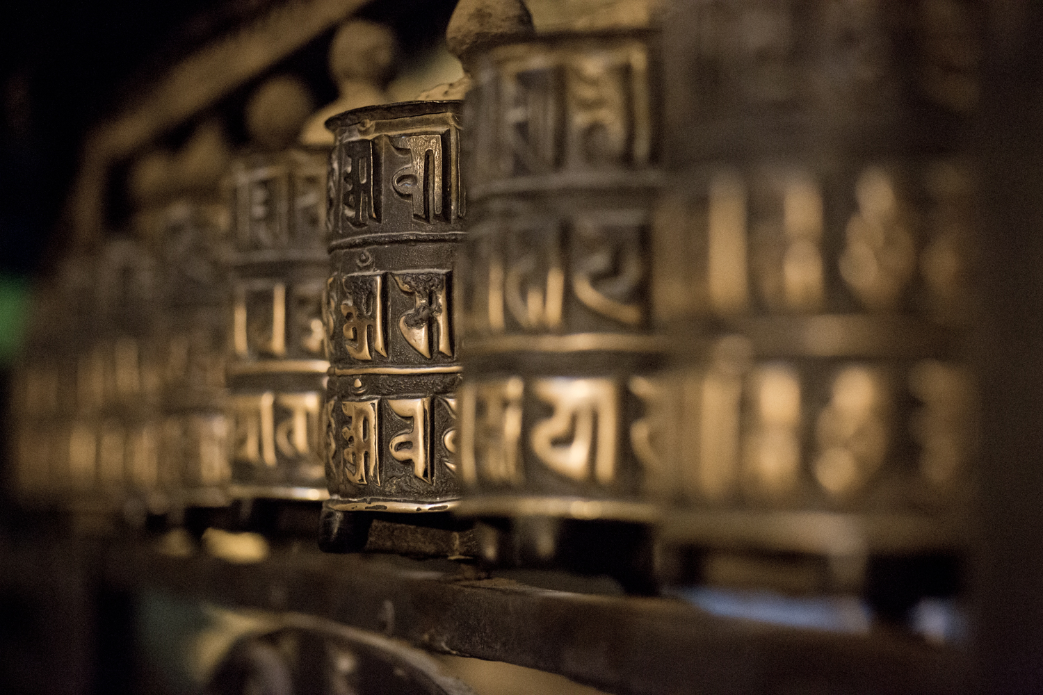 "Prayer wheels at Swayambhunath (also known as the ""Monkey Temple"") in Nepal. The uphill slog to  Swayambhunath is worth the paranoramic view of the city."