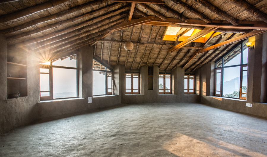 The second-story meditation and yoga space offers a beautiful setting for spiritual practice and workshops.