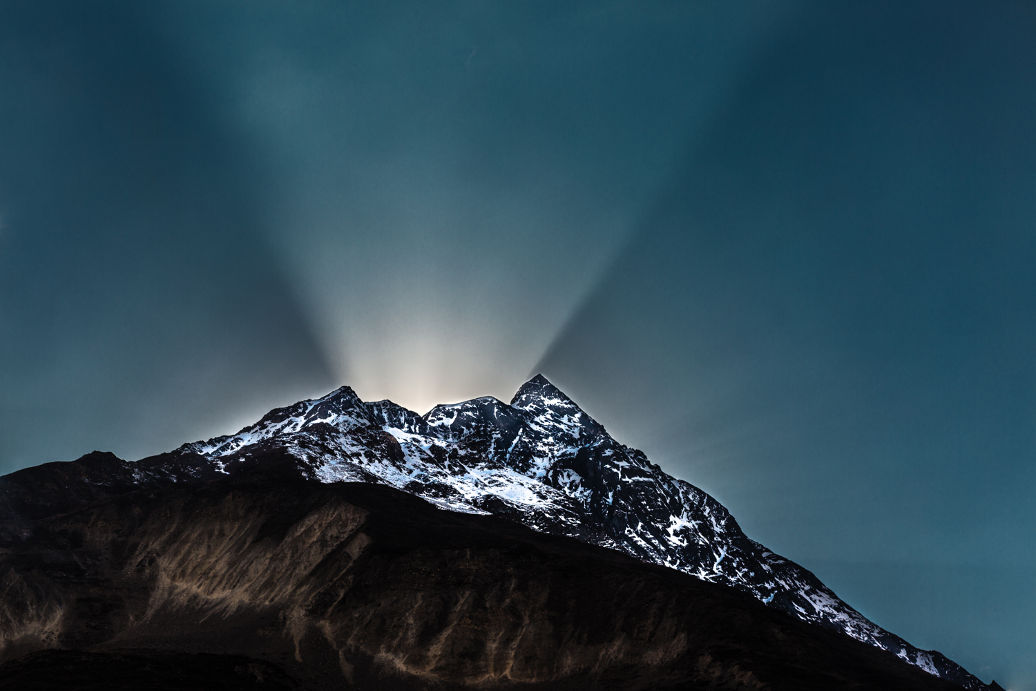 "The light of dusk transformed this himal (""mountain"")  into a light volcano. Photographed near the Larke Pass in Nepal's Manaslu reserve."