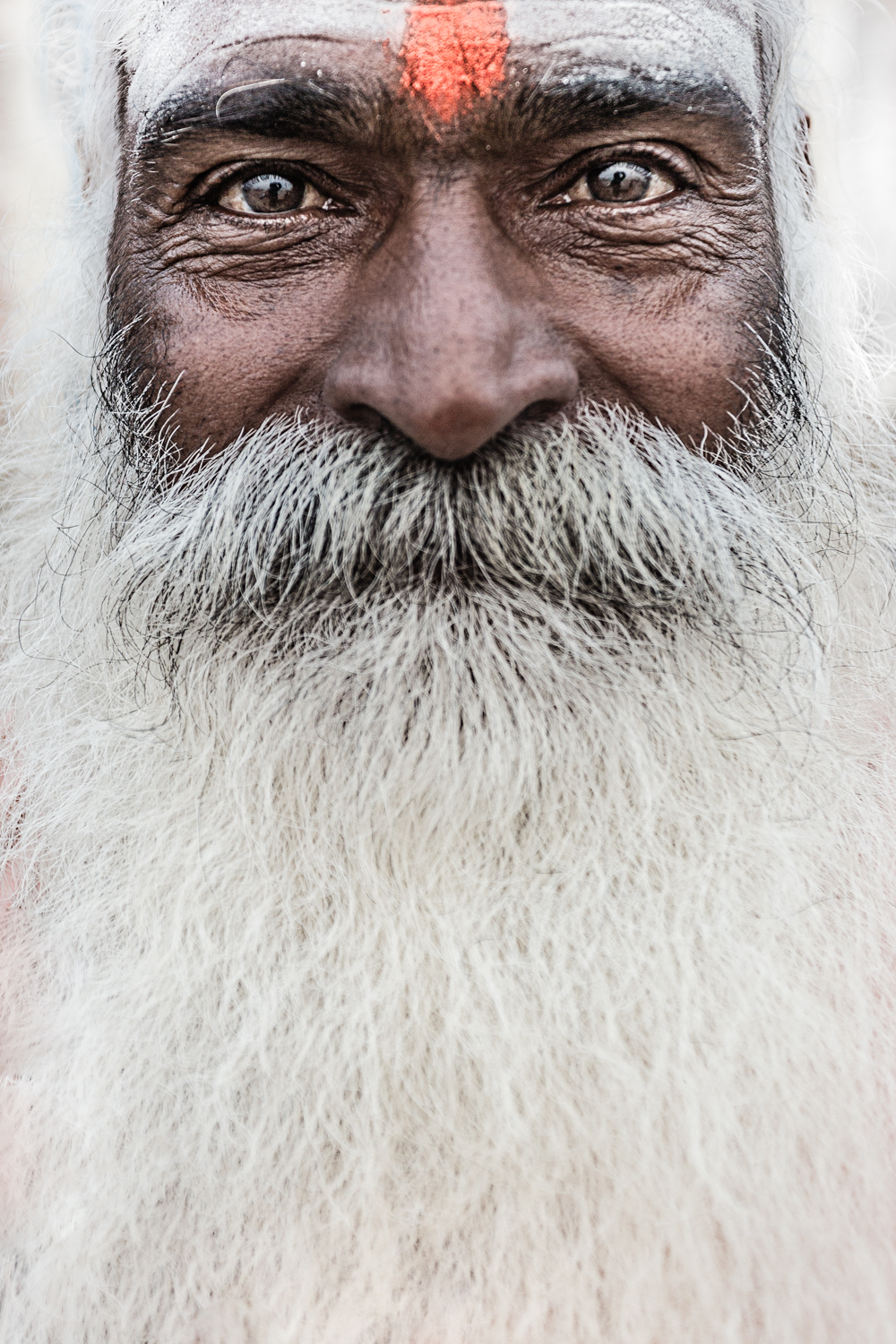 """A   sādhu   is a Hindu ascetic commonly called  baba ( meaning elder such as father, grandfather or uncle) or """"baba-ji"""" (with a suffix for added endearment) by common people. They are essentially homeless and usually nomadic. Becoming a sādhu involves a guru deciding that a sisya (the person desiring to become a  sādhu)  ready to take sannyasa, the life state of renunciation in which a person — usually after family life — renounces worldly and materialistic pursuits and dedicate their lives to the attainment of freedom from   saṃsāra  , the cycle of death and rebirth, by attaining enlightenment. Sadhus are considered dead unto themselves and are legally dead to the state of India. Most live off of the charitable contributions of lay people."""