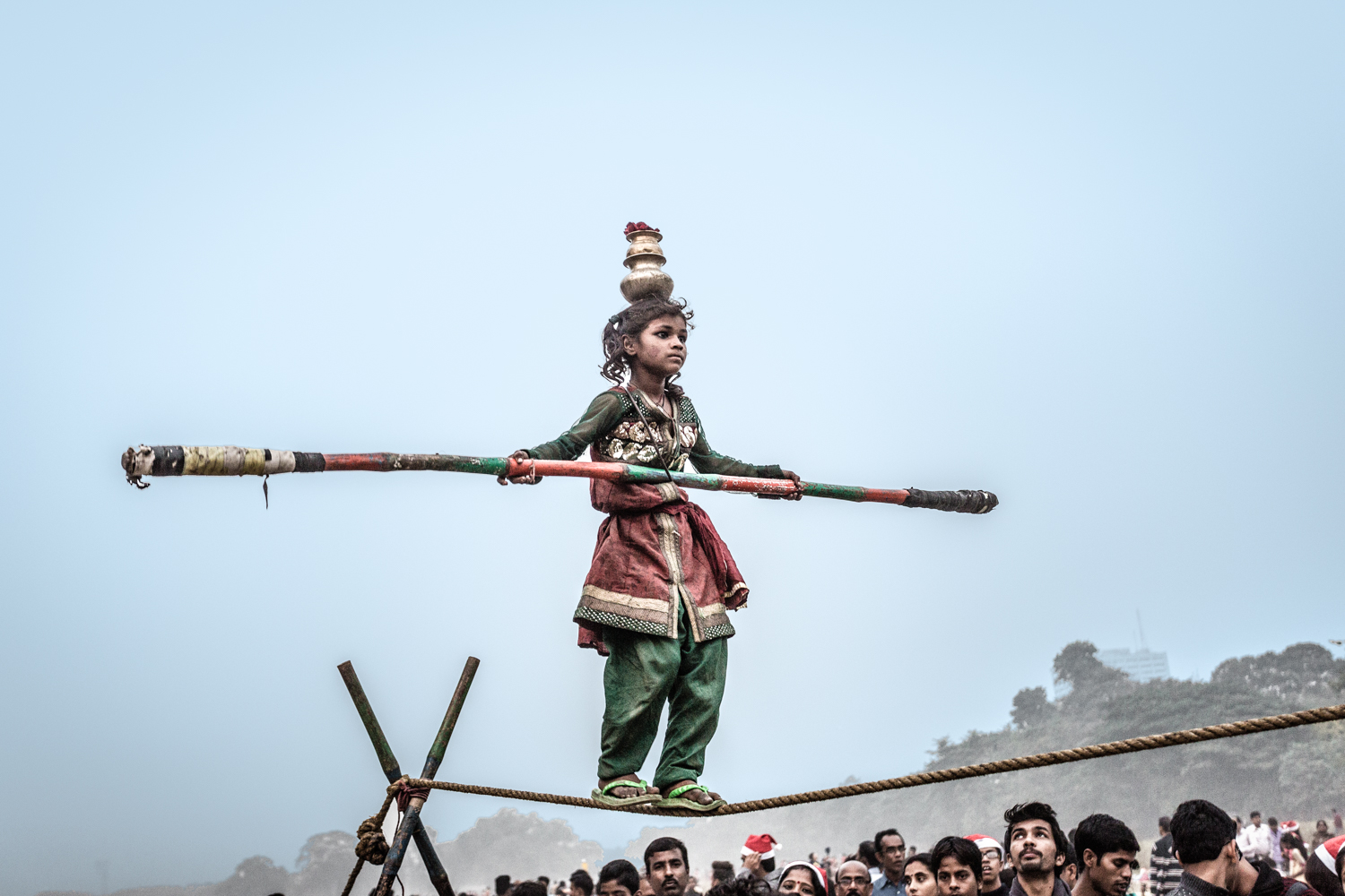 In the Maiden, a young girl performs acrobatic feats for alms.