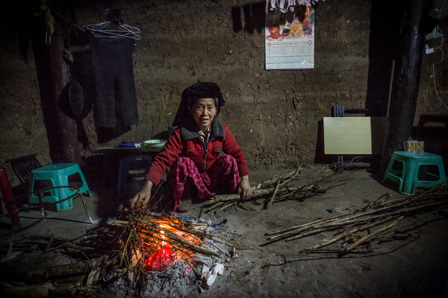 A member of the White Hmong ethnic minority photographed inside her traditional rammed-earth home in Ha Giang Province, one kilometer from the Chinese border. I met her son while traveling in the area and spent the night in their humble abode.