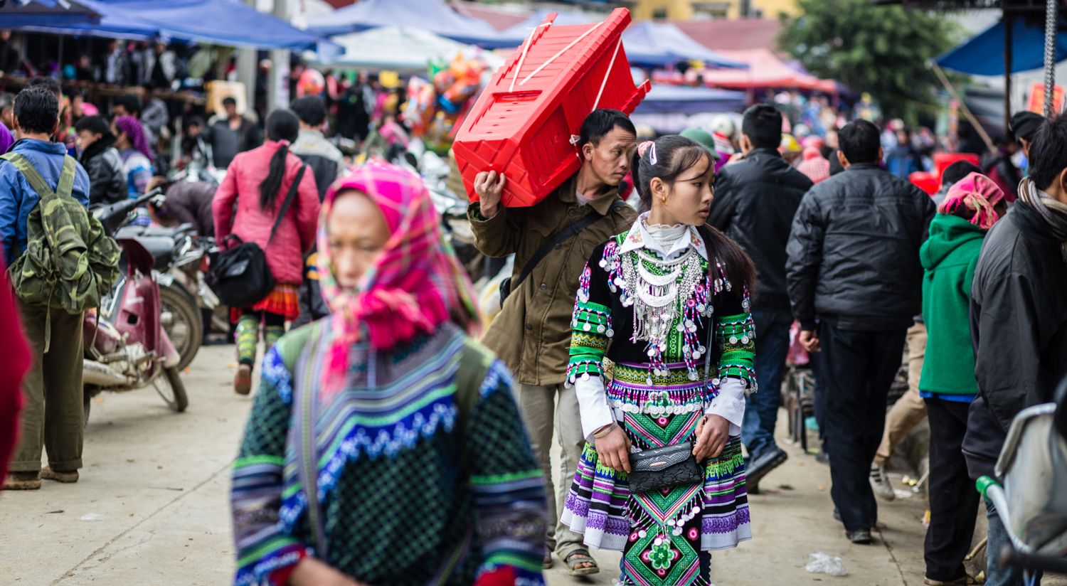 Villagers from all over the area flock to the Sunday Bac Ha market in Lao Coi Province. In addition to shopping for commodities ranging from meat to clothing, the market is very much a social occasion for the Flower Hmong, who go to the market dressed to impress