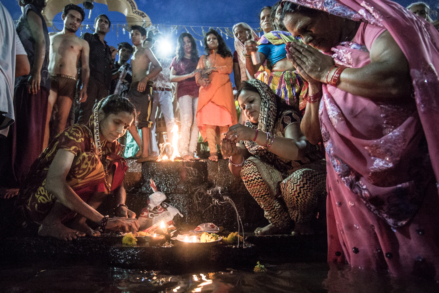 Women performing a fire puja on the banks of the Shipra during the 2016 Kumbh Mela in Ujjain.