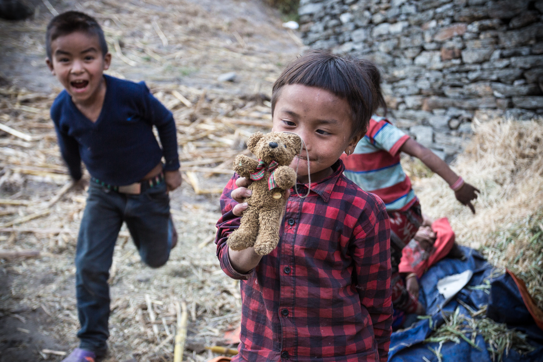 Village children playing inside the Manaslu Reserve.