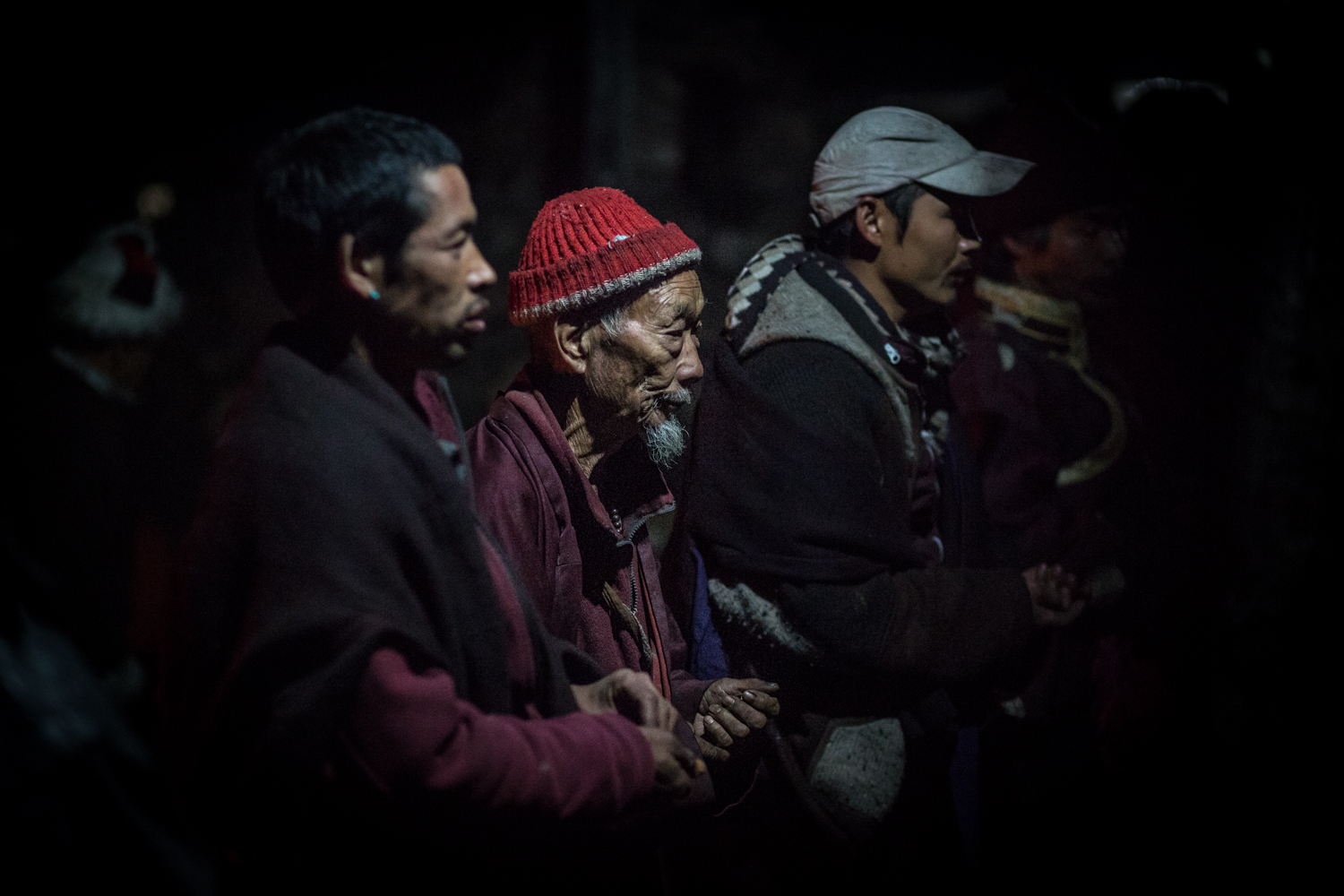 Villagers in Namrung watch a performance but on by local monks. Namei dum je is held annually by the local monastery. Lamas pray and put on performances to earn donations from the townspeoples.