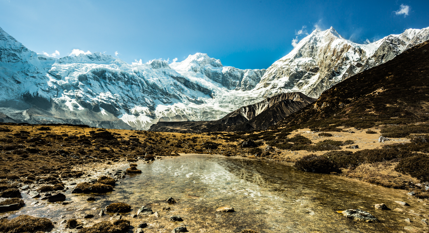 A section of the Manaslu massif. Manaslu, recognizable by its doubled-edged peaks, is on the far right, .