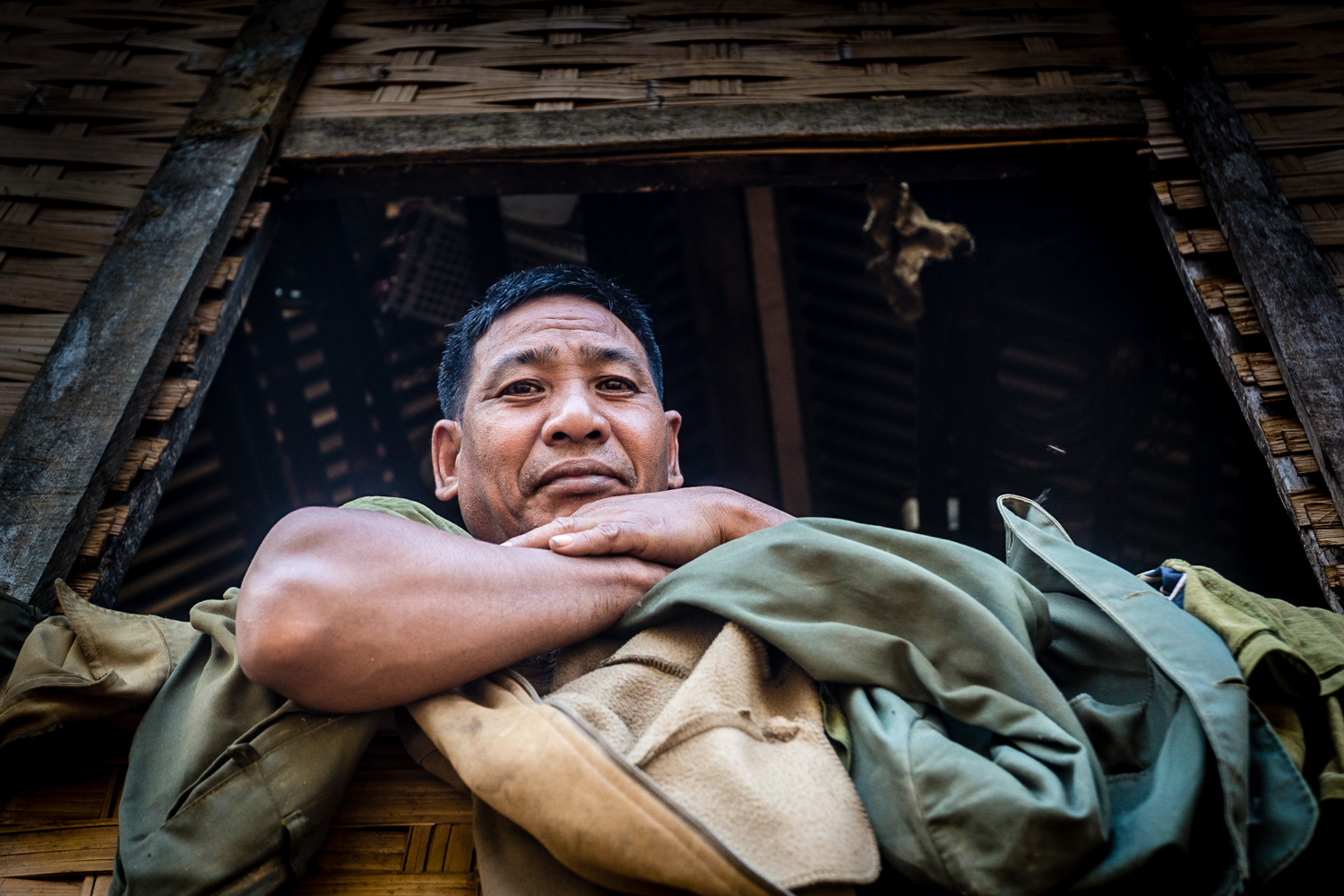 Villager inside his abode in the outskirts of Muang Ngoy.