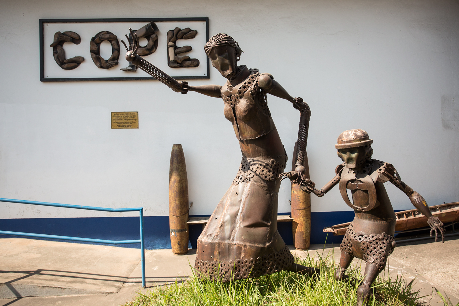 COPE Visitor Center. This statue,made from scraps of exploded ordinances,memorializes the victims of unexploded ordinances..