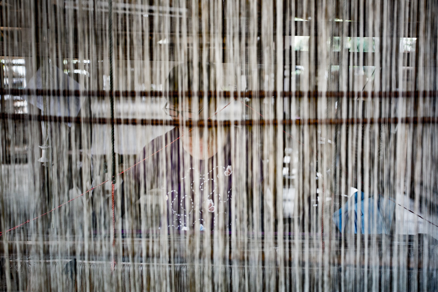 Women weaving using a traditional loom in a workshop in Nong Bua.