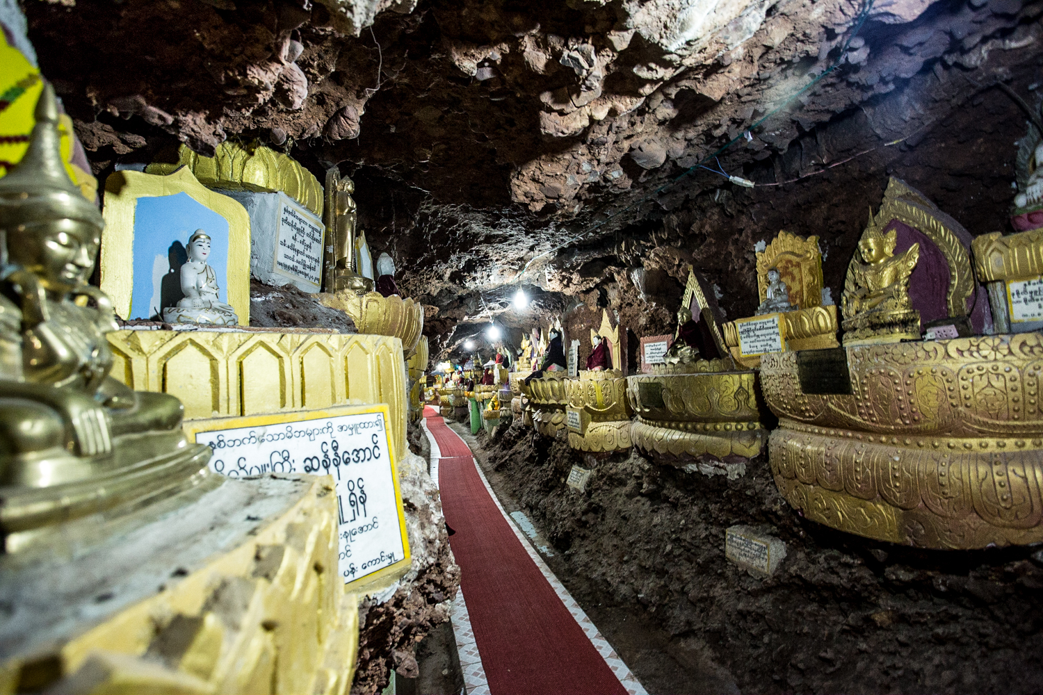 Shwe Oo Min Paya, Myin Ma Hti Cave, suppossedly built more than 2000 years ago, features thousands of Buddha statuettes.