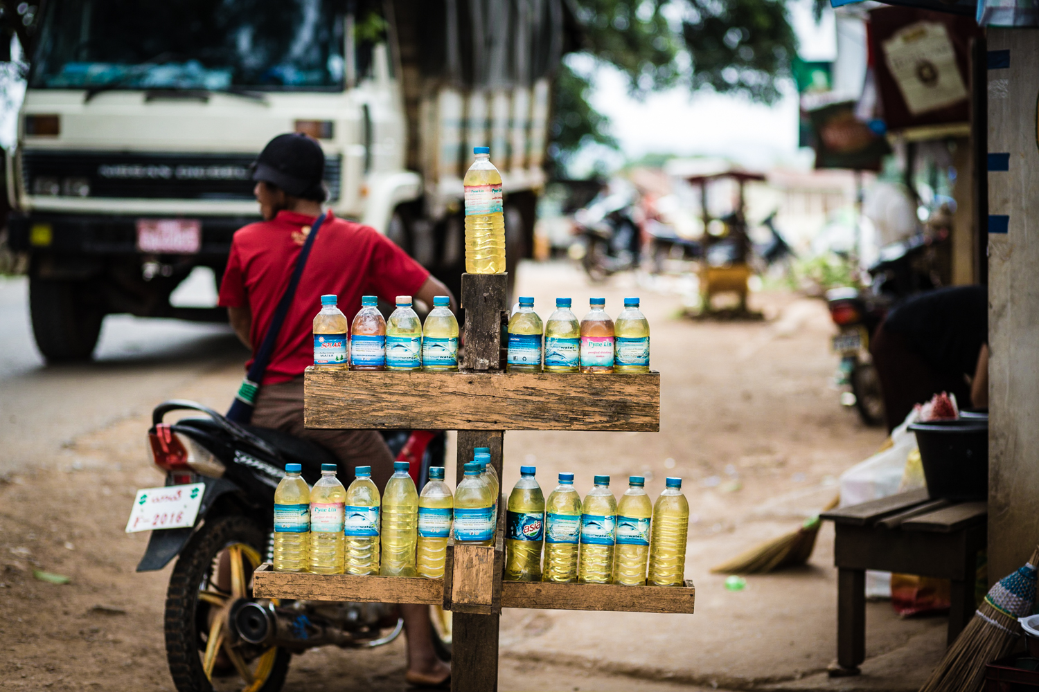 Petrol for sale in re-used plastic water bottles. Very common in Indochina.