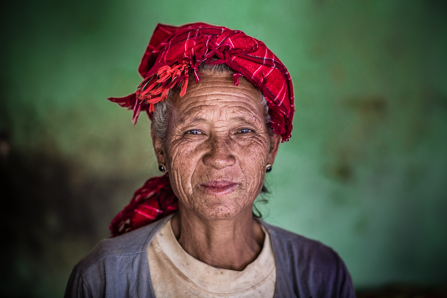 A woman wearing a traditional headscarf.