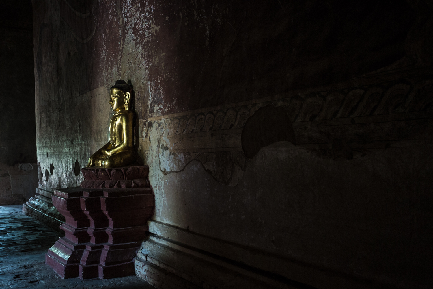 Relatively new Buddhas grace otherwise ancient structures.