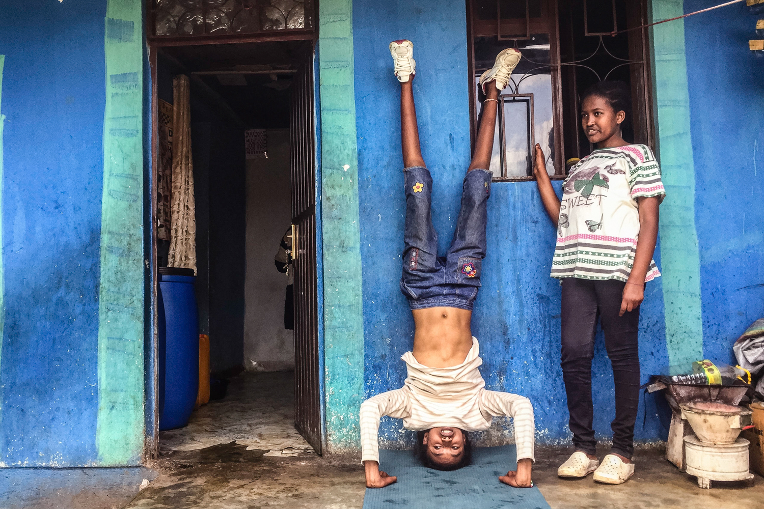 I taught yoga to the kids. Ketamesh (left) stayed after class to work on more advanced postures.