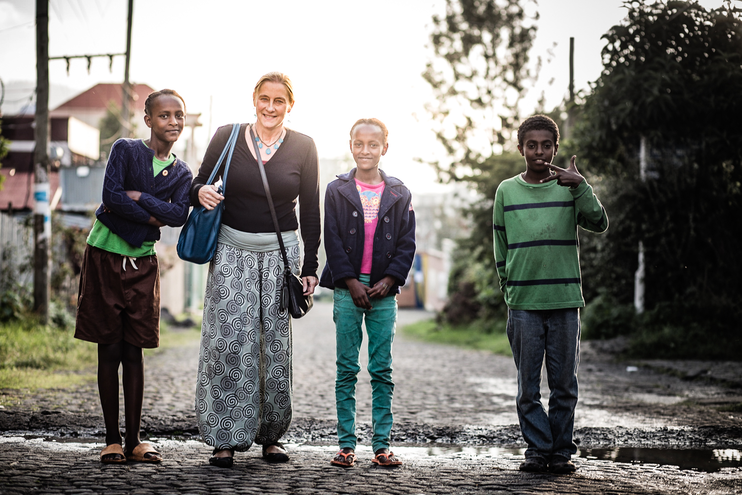 Claudia with a few of the Origins Homes kids near their home.